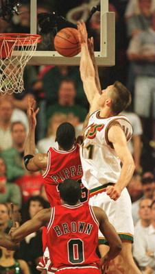 14 Jun 1996: Detlef Schrempf of the Seattle Supersonics blocks a shot by Scottie Pippen of the Chicago Bulls with Randy Brown #0 watching from the floor as the Sonics win game five of the NBA Finals over the Bulls by 89-78 at Key Arena in Seattle, Washing