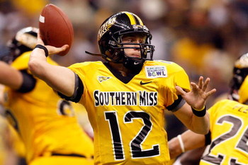 NEW ORLEANS - DECEMBER 21: Quarterback Austin Davis #12 of the Southern Mississippi Golden Eagles looks to throw a pass against the Troy Trojans during the R+L Carriers New Orleans Bowl on December 21, 2008 at the Superdome in New Orleans, Louisiana. Davi