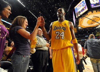 LOS ANGELES, CA - MAY 27:  Kobe Bryant #24 of the Los Angeles Lakers gives a fan a five after defeating the Denver Nuggets 103-94 in Game Five of the Western Conference Finals during the 2009 NBA Playoffs at Staples Center on May 27, 2009 in Los Angeles,