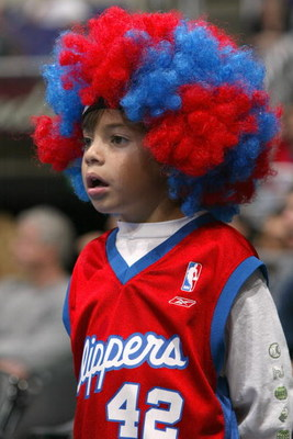 LOS ANGELES - OCTOBER 24:  A Los Angeles Clippers fan watches the action during a preseason game against the New Orleans Hornets on October 24, 2004 at Staples Center in Los Angeles, California. The Clippers won 97-93. NOTE TO USER: User expressly acknowl