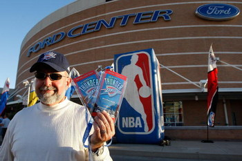 OKLAHOMA CITY - OCTOBER 29:  A fan poses with tickets to opening night between the Milwaukee Bucks and the Oklahoma City Thunder at the Ford Center on October 29, 2008 in Oklahoma City, Oklahoma. The Bucks won 98-87.  NOTE TO USER: User expressly acknowle