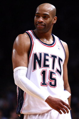 NEW YORK - MARCH 18: Vince Carter #15 of the New Jersey Nets watches on against the New York Knicks at Madison Square Garden March 18, 2009 in New York City. NOTE TO USER: User expressly acknowledges and agrees that, by downloading and/or using this Photo