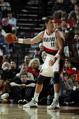 PORTLAND, OR - FEBRUARY 19:  Arvydas Sabonis #11 of the Portland Trail Blazers is defended by Adonal Foyle #31 of the Golden State Warriors during the NBA game at Rose Garden on February 19, 2003 in Portland, Oregon.  The Trail Blazers won 125-98.  NOTE T