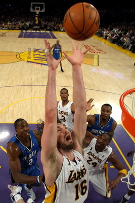 LOS ANGELES, CA - JUNE 07:  Pau Gasol #16 of the Los Angeles Lakers goes up for a rebound in front of Dwight Howard #12 of the Orlando Magic in Game Two of the 2009 NBA Finals at Staples Center on June 7, 2009 in Los Angeles, California. NOTE TO USER: Use