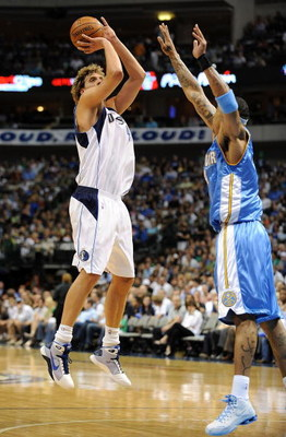 DALLAS - MAY 09:  Forward Dirk Nowitzki #41 of the Dallas Mavericks takes a shot against Kenyon Martin #4 of the Denver Nuggets in Game Three of the Western Conference Semifinals during the 2009 NBA Playoffs at American Airlines Center on May 9, 2009 in D