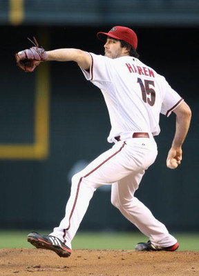 PHOENIX - MAY 28:  Starting pitcher Dan Haren #15 of the Arizona Diamondbacks pitches against the Atlanta Braves during the major league baseball game at Chase Field on May 28, 2009 in Phoenix, Arizona.   The Diamondbacks defeated the Braves 5-2. (Photo b
