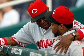 KANSAS CITY, MO - JUNE 12:   Manager Dusty Baker #12 of the Cincinnati Reds talks with Johnny Cueto #47 prior to the start of the game against  the Kansas City Royals on June 12, 2009 at Kauffman Stadium in Kansas City, Missouri.  (Photo by Jamie Squire/G