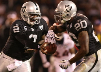 OAKLAND, CA - SEPTEMBER 08:  JaMarcus Russell #2 of the Oakland Raiders hands the ball off to Darren McFadden #20 against the Denver Broncos during an NFL game at McAfee Coliseum on September 8, 2008 in Oakland, California.  (Photo by Jed Jacobsohn/Getty