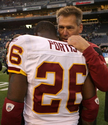SEATTLE - NOVEMBER 23:  Head coach Jim Zorn of the Washington Redskins talks to running back Clinton Portis #26 after defeating the Seattle Seahawks 20-17 on November 23, 2008 at Qwest Field in Seattle, Washington. (Photo by Otto Greule Jr/Getty Images)