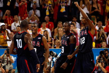 BEIJING - AUGUST 24: Kobe Bryant #10 of the United States celebrate a play with teammates Chris Paul #13, Dwyane Wade #9 and Chris Bosh #12 in the gold medal game against Spain during Day 16 of the Beijing 2008 Olympic Games at the Beijing Olympic Basketb