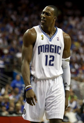 ORLANDO, FL - JUNE 11:  Dwight Howard #12 of the Orlando Magic reacts in the third quarter of Game Four of the 2009 NBA Finals against the Los Angeles Lakers on June 11, 2009 at Amway Arena in Orlando, Florida.  NOTE TO USER:  User expressly acknowledges