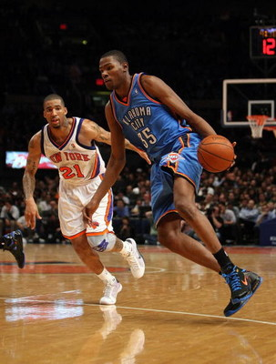 NEW YORK - NOVEMBER 14:  Kevin Durant #35 of the Oklahoma City Thunder drives past Wilson Chandler #21 of the New York Knicks on November 14, 2008 at Madison Square Garden in New York City, New York. NOTE TO USER: User expressly acknowledges and agrees th
