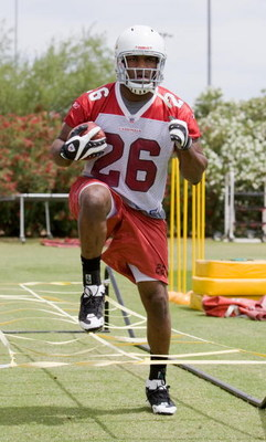 TEMPE, AZ - MAY 2 :  Chris Wells #26 of the Arizona Cardinals runs drills during a team minicamp at the team training facility on May 2, 2009 in Tempe, Arizona.  (Photo by Jonathan Willey/Getty Images)