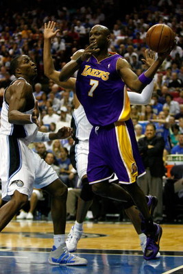 ORLANDO, FL - JUNE 11:  Lamar Odom #7 of the Los Angeles Lakers looks to pass over Dwight Howard #12 and Mickael Pietrus #20 of the Orlando Magic in Game Four of the 2009 NBA Finals on June 11, 2009 at Amway Arena in Orlando, Florida.  NOTE TO USER:  User