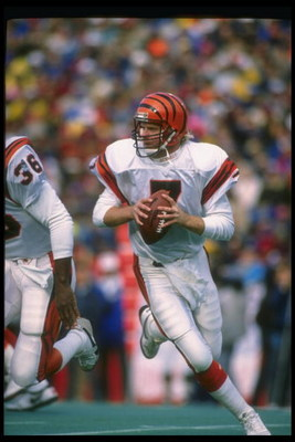 26 Nov 1989: Quarterback Boomer Esiason of the Cincinnati Bengals looks to pass the ball during a game against the Buffalo Bills at Rich Stadium in Orchard Park, New York. The Bills won the game, 24-7.