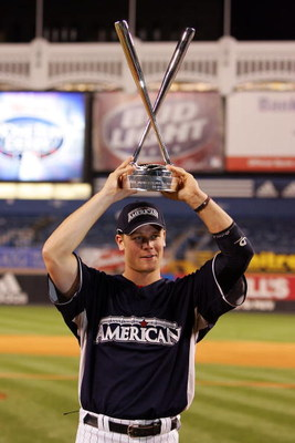 NEW YORK - JULY 14:  Justin Morneau of the Minnesota Twins  holds the trophy for the 2008 MLB All-Star State Farm Home Run Derby at Yankee Stadium on July 14, 2008 in the Bronx borough of New York City.  (Photo by Jim McIsaac/Getty Images)