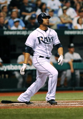 ST. PETERSBURG, FL - APRIL 15: Infielder Carlos Pena #23 of the Tampa Bay Rays homers against the New York Yankees at Tropicana Field on April 15, 2009 in St. Petersburg, Florida.  (Photo by Al Messerschmidt/Getty Images)