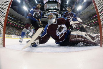 ST. PAUL, MN - APRIL 16:  Goalie Patrick Roy #33 of the Colorado Avalanche follows the puck as it flies behind the goal against the Minnesota Wild during game four of the first round of the 2003 Stanley Cup playoffs at the Xcel Center on April 16, 2003 in