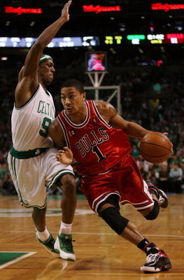 BOSTON - MAY 02:  Derrick Rose #1 of the Chicago Bulls drives to the net as Rajon Rondo #9 of the Boston Celtics defends in Game Seven of the Eastern Conference Quarterfinals during the 2009 NBA Playoffs at TD Banknorth Garden on May 2, 2009 in Boston, Ma