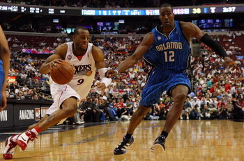PHILADELPHIA - APRIL 26:  Andre Iguodala #9 of the Philadelphia 76ers drives against Dwight Howard #12 of the Orlando Magic during Game Four of the Eastern Conference Quarterfinals during the 2009 NBA Playoffs at the Wachovia Center on April 26, 2009 in P