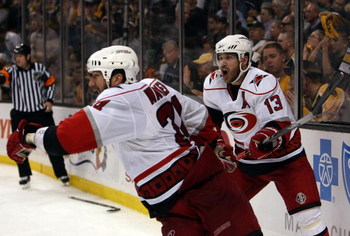 BOSTON - MAY 14:  Scott Walker #24 and Ray Whitney #13 of the Carolina Hurricanes celebrate Walker's game winning goal in overtime against the Boston Bruins during Game Seven of the Eastern Conference Semifinal Round of the 2009 Stanley Cup Playoffs on Ma