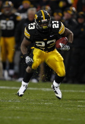 IOWA CITY, IOWA - NOVEMBER 8: Shonn Greene #23 of the Iowa Hawkeyes rushes for yards in the third quarter of play against the Penn State Nittany Lions at Kinnick Stadium on November 8, 2008 in Iowa City, Iowa. Iowa defeated Penn State  24-23. (Photo by Da