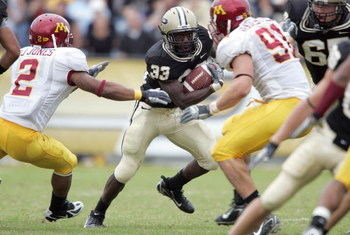 WEST LAFAYETTE, IN - SEPTEMBER 23:  Jaycen Taylor #33 of the Purdue Boilermakers rushes the ball against the Minnesota Golden Gophers during a Big Ten Conference game September 23, 2006 at Ross-Ade Stadium in West Lafayette, Indiana.  Purdue won 27-21. (P