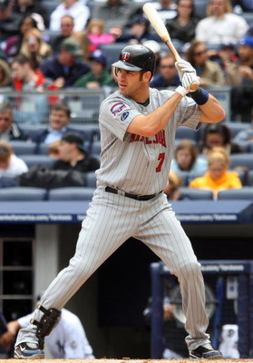 NEW YORK - MAY 17:  Joe Mauer #7 of the Minnesota Twins bats against the New York Yankees on May 17, 2009 at Yankee Stadium in the Bronx borough of New York City. The Yankees defeated the Twins 3-2 in ten innings.  (Photo by Jim McIsaac/Getty Images)