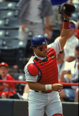 17 May 2000:  Catcher Ivan Rodriguez #7 of the Texas Rangers catches the ball during a game against the Tampa Bay Devil Rays at The Ball Park in Arlington, Texas. The Rangers defeated the Devil Rays 11-6.Mandatory Credit: Chris Covatta  /Allsport