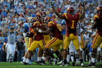 PASADENA, CA - DECEMBER 06: Stafon Johnson #13 of the USC Trojans rushes in for a touchdown in the second quarter against the UCLA Bruins on December 6, 2008 at the Rose Bowl in Pasadena, California.  (Photo by Harry How/Getty Images)