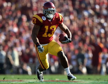 PASADENA, CA - JANUARY 01:  Stafon Johnson #13 of the USC Trojans rushes the ball during the 95th Rose Bowl Game presented by Citi against the Penn State Nittany Lions at the Rose Bowl on January 1, 2009 in Pasadena, California. The Trojans defeated the N