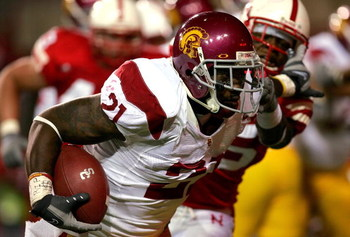 LINCOLN, NE - SEPTEMBER 15:  Allen Bradford #21 of the USC Trojans carries the ball against the Nebraska Cornhuskers on September 15, 2007 at Memorial Stadium in Lincoln, Nebraska.  (Photo by Matthew Stockman/Getty Images)