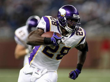 DETROIT - DECEMBER 07:  Running back Adrian Peterson #28 of the Minnesota Vikings rushes the ball for 22 yards during the third quarter of the NFL game against the Detroit Lions at Ford Field on December 7, 2008 in Detroit, Michigan. The Vikings defeated