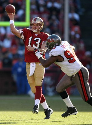 SAN FRANCISCO - DECEMBER 23:  Shaun Hill #13 of the San Francisco 49ers passes against Greg Spires #94 of the Tampa Bay Buccaneers during an NFL game at Monster Park December 23, 2007 in San Francisco, California.  (Photo by Jed Jacobsohn/Getty Images)