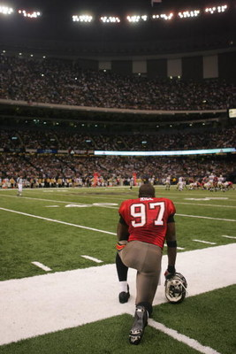 NEW ORLEANS -OCTOBER 8:  Defensive end Simeon Rice #97 of the Tampa Bay Buccaneers watches the game against the New Orleans Saints at the Louisiana Superdome on October 8, 2006 in New Orleans, Louisiana. The Saints won 24-21.  (Photo by Ronald Martinez/Ge