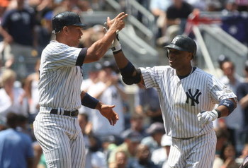 NEW YORK - JUNE 14:  Robinson Cano #24 of the New York Yankees celebrates hitting a two RBI home run in the fourth inning with teammate Alex Rodriguez #13 against the New York Mets on June 14, 2009 at Yankee Stadium in the Bronx borough of New York City.