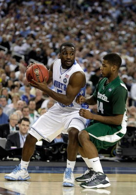 DETROIT - APRIL 06:  Ty Lawson #5 of the North Carolina Tar Heels  looks to drive on Korie Lucious #34 of the Michigan State Spartans during the 2009 NCAA Division I Men's Basketball National Championship game at Ford Field on April 6, 2009 in Detroit, Mi