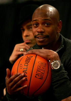 LAS VEGAS - FEBRUARY 18:  Comedian Dave Chappelle watches the 2007 NBA All Star Game on February 18, 2007 at Thomas & Mack Center in Las Vegas, Nevada.  NOTE TO USER: User expressly acknowledges and agrees that, by downloading and or using this photograph