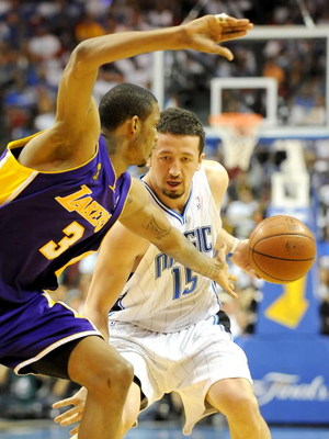 ORLANDO, FL - JUNE 14:  Hedo Turkoglu #15 of the Orlando Magic moves the ball as Trevor Ariza #3 of the Los Angeles Lakers goes for the steal in the third quarter of Game Five of the 2009 NBA Finals on June 14, 2009 at Amway Arena in Orlando, Florida.  NO