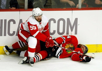 CHICAGO - MAY 22:  Martin Havlat #24 of the Chicago Blackhawks lies on the ice motionless after he was checked hard by Niklas Kronwall #55 of the Detroit Red Wings during the first period of Game Three of the Western Conference Championship Round of the 2