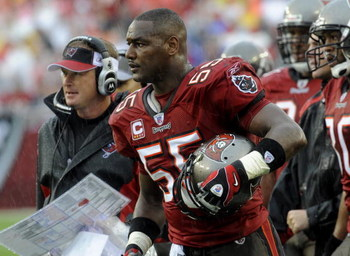 TAMPA, FL - NOVEMBER 30: Linebacker Derrick Brooks #55 of the Tampa Bay Buccaneers watches play against the New Orleans Saints at Raymond James Stadium on November 30, 2008 in Tampa, Florida.  (Photo by Al Messerschmidt/Getty Images)