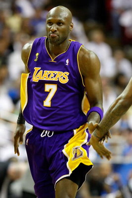 ORLANDO, FL - JUNE 14:  Lamar Odom #7 of the Los Angeles Lakers reacts in the third quarter against the Orlando Magic in Game Five of the 2009 NBA Finals on June 14, 2009 at Amway Arena in Orlando, Florida.  NOTE TO USER:  User expressly acknowledges and