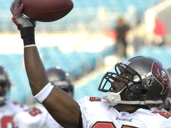 JACKSONVILLE, FL - AUGUST 18: Cornerback Brian Kelly #25 of the Tampa Bay Buccaneers grabs a warm-up pass before play against the Jacksonville Jaguars at Jacksonville  Municipal Stadium on August 18, 2007 in Jacksonville, Florida. (Photo by Al Messerschmi