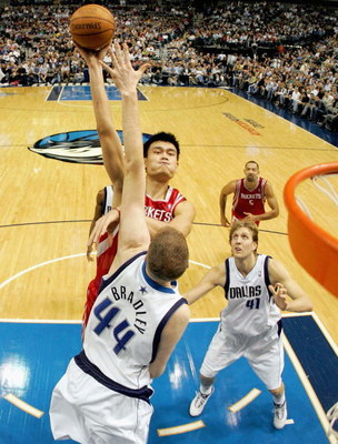 DALLAS - JANUARY 12:  Center Yao Ming #11 of the Houston Rockets takes a shot against Shawn Bradley #44 of the Dallas Mavericks at the American Airlines Center on January 12, 2005  in Dallas, Texas.   (Photo by Ronald Martinez/Getty Images)