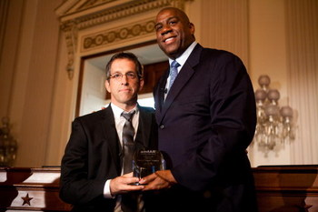 WASHINGTON - MAY 13: Kenneth Cole, chairman of the board of amfAR (The Foundation for AIDS Research), presents the amfAR Award of Courage to former basketball player Earvin 'Magic' Johnson (R) at a forum on HIV/AIDS on Capitol Hill on May 13, 2009 in Wash
