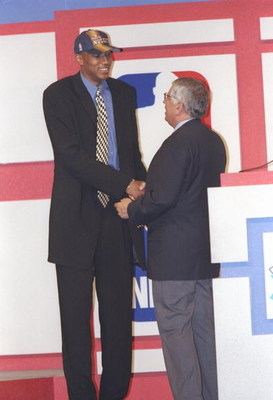 25 Jun 1997:  Forward Tony Battie of the Denver Nuggets shakes hands with NBA Commissioner David Stern during the NBA Draft at the Charlotte Coliseum in Charlotte, North Carolina. Mandatory Credit: Craig Jones  /Allsport