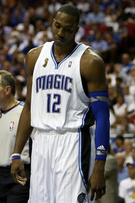 ORLANDO, FL - JUNE 14:  Dwight Howard #12 of the Orlando Magic looks down in the fourth quarter as the Magic trail the Los Angeles Lakers in Game Five of the 2009 NBA Finals on June 14, 2009 at Amway Arena in Orlando, Florida.  NOTE TO USER:  User express
