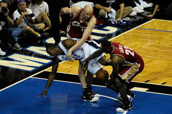 ORLANDO, FL - MAY 24:  LeBron James #23 of the Cleveland Cavaliers steals the ball from Dwight Howard #12 of the Orlando Magic in Game Three of the Eastern Conference Finals during the 2009 NBA Playoffs at the the Amway Arena on May 24, 2009 in Orlando, F