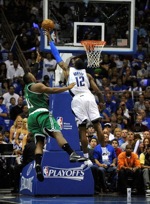 ORLANDO, FL - MAY 14:   Dwight Howard #12 of the Orlando Magic blocks the shot of Glen Davis #11 of the Boston Celtics in Game Six of the Eastern Conference Semifinals during the 2009 NBA Playoffs at Amway Arena on May 14, 2009 in Orlando, Florida.  NOTE