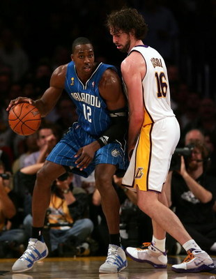 LOS ANGELES, CA - JUNE 07:  Dwight Howard #12 of the Orlando Magic posts up Pau Gasol #16 of the Los Angeles Lakers in the second half of Game Two of the 2009 NBA Finals at Staples Center on June 7, 2009 in Los Angeles, California. NOTE TO USER: User expr